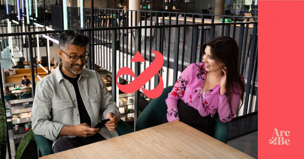 smart man and business woman sitting together at place of work